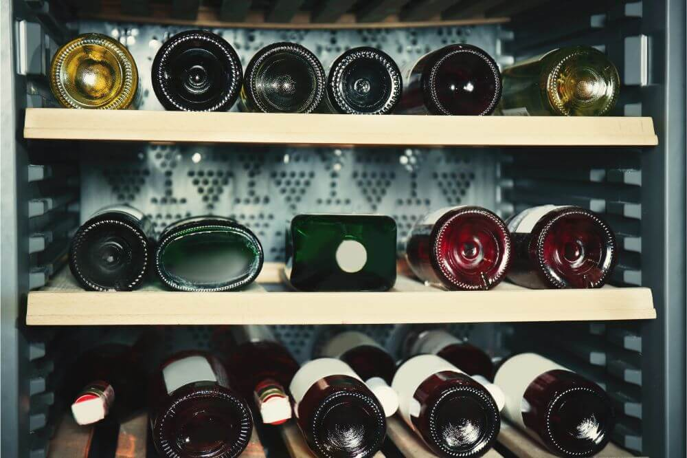wine bottles in wine fridge