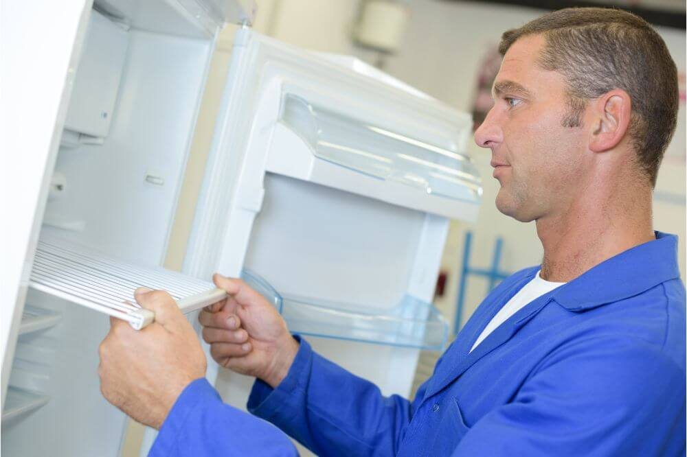 Man holding a fridge shelf