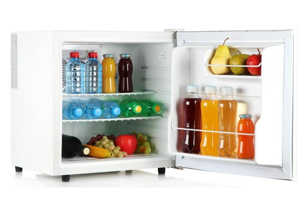 Mini Fridge with fruits, bottled water and juices
