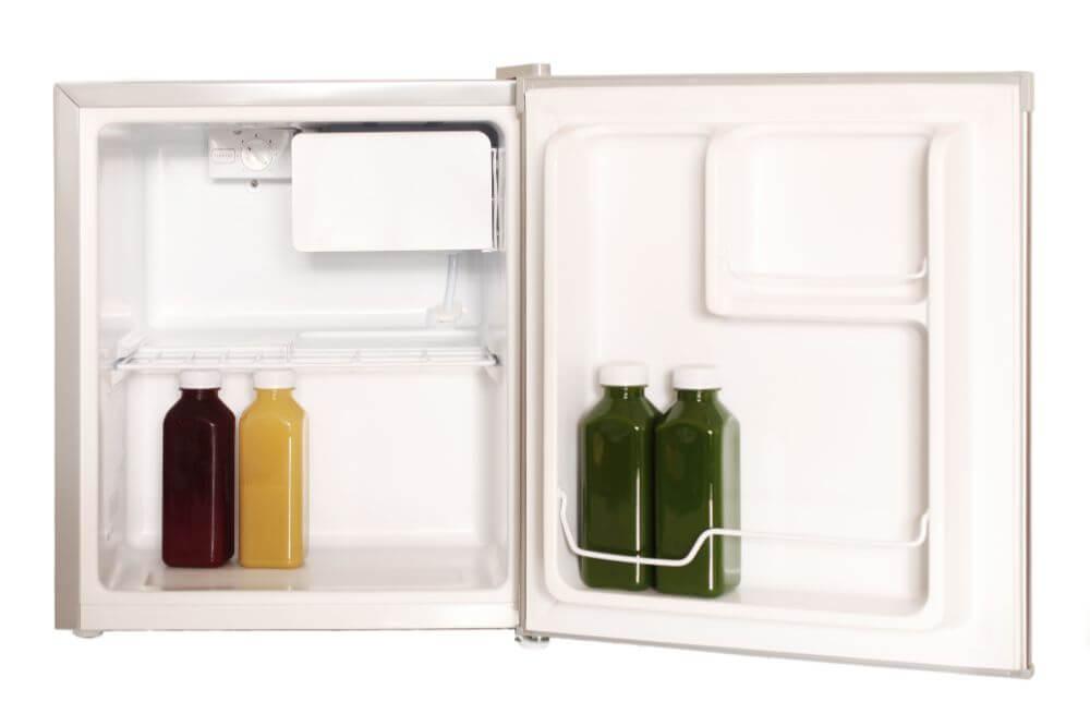 open mini fridge with 4 bottles inside